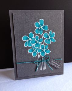 Using COLORED PENCILS (Prismacolor) Used just two shades of blues on this one on white embossed dark gray panel. Added enamel dots, twine and an elongated tag with a sentiment stamped with versamark and white embossed. I added texture to the panel by embossing with texture plate. I'm in Haven: Coloring on Colored Paper