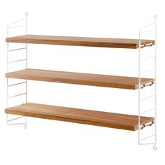 € 139 String Pocket is a lightweight shelf manufactured by the Swedish company String Furniture. String Pocket comes in fixed combinations consisting of 2 side panels and 3 shelves. String Pocket, Oak Shelves, Storage Shelves, Walnut Shelves, White Shelves, White Bookshelves, Wall Shelving, Shelving Design, Nordic Design
