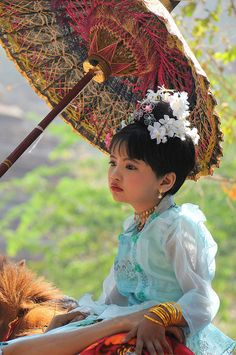 A young girl dressed for a religious festival in Myanmar.