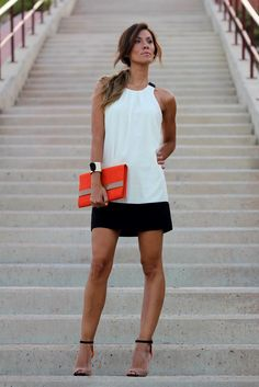 Love this simple, but elegant black and white dress wih a fun pop of color!