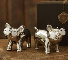 Piggies Salt & Pepper Set #potterybarn- got these as a Christmas gift. Very cute on our dining room table, but don't hold enough salt/pepper