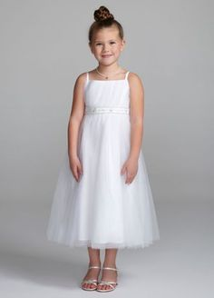 Your flower girl will feel and look just like a princess in this exceptionally stunning mini ball gown!  Spaghetti strap bodice features sparkling beaded embroidery at waist for an eye-catching look.  Full tulle ball gown adds a touch of drama to this already sensantional ensemble.  Sizes 2T-14.  Coordinates with Bridal Gown CPK440.  Fully lined. Back zip. Imported polyester. Dry clean.
