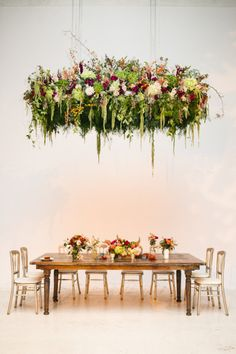 Floral Chandelier. Pinned by Afloral.com from http://www.stylemepretty.com/gallery/picture/1429606/ ~Find high-quality silk flowers at Afloral.com for your DIY wedding on a budget.