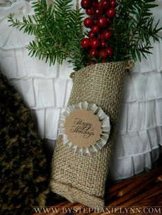 Cover a paper towel tube in burlap and embellish for a cute door hanger!