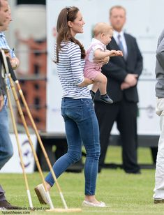 June 15, 2015: The Duchess and Prince George were at Cirencester Park Polo Club, where Prince William and Prince Harry took part in the annual Jerudong Trophy Polo Match. The Duchess teamed a nautical breton top by London-based brand Me + Em with light-blue skinny jeans - most likely by J Brand, - and Sebago Bala boat shoes.