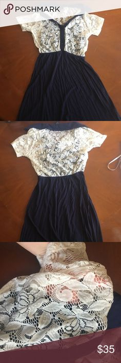 Navy & white lace dress Gently worn. Had a slip underneath the lace that is navy. Can dress up or down- with heels or throw a cardigan over.                                                           Measurements.                                                                                                                    -pit to pit: 16 in -waist: 11 in but stretches to over 16 in - length: 32 in Dresses