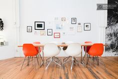 A big and bright artist loft space in Chicago has a mix of vintage and modern chairs.
