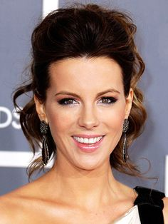 KATE BECKINSALE  Flawless skin and a bombshell ponytail complemented Kate's kicky Zuhair Murad mini at the Grammys. Because her updo had plenty going on (between the teased pouf and cascade of curls), all she needed for her makeup to make an impact was thick lashes and rosy cheeks.