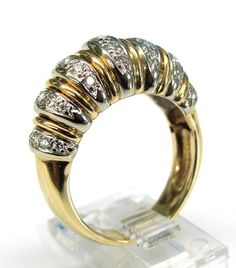Ladies 14kt yellow and white gold diamond estate ring. Ring contains 35 brilliant round cut diamonds weighing a total of approximately .75ct.