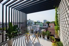narrow townhouse in vietnam by MM++ features a retractable shutter screen