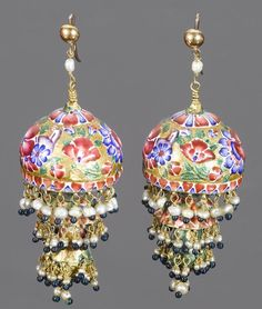Persia   A pair of Qajar enamelled and gold Earrings; each comprising three sections: two domic and one drop-shaped, all with pearl and seed pearl suspension, enamelled in polychrome with floral designs   19th century   1'320£ ~ Sold