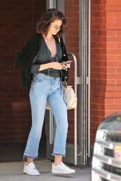 Selena Gomez wearing Coach Selena Grace Bag, Alice + Olivia Tasha Cropped Frayed Jeans in Sun-Bleached Denim, Louis Vuitton Frontrow Leather Sneakers, Rouje Yasmine Top With Dots Print and Rouje Anna Top Selena Gomez Fashion, Selena Gomez Outfits, Selena Gomez Fotos, Selena Gomez Style, Look Fashion, Girl Fashion, Fashion Outfits, Celebrity Outfits, Celebrity Style