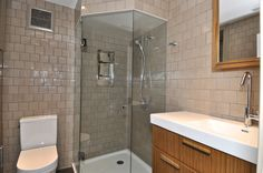 Glass shower with and angled door.