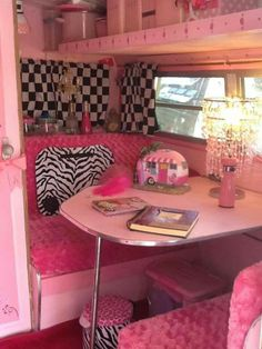 Pink?  Yes and it is gorgeous.  Definitely a lady's camper and she travels in style.  Love the accents.