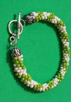 Sold out! Come and visit my shop for more fabulous gift ideas. Green and White Kumihimo Bracelet, Beaded Kumihimo Bracelet, Bracelets Seed Beads by MyIslandDream on Etsy
