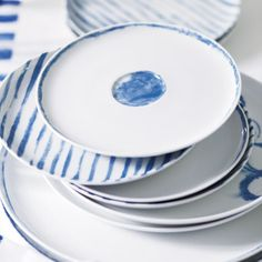 Jinshi Porcelain covers tableware from mugs to pasta bowls with its charming watercolour indigo detailing