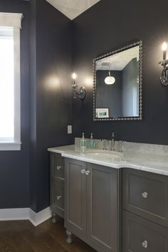 Classy powder room with rich paint color and custom furniture-leg vanity cabinet. Furniture Legs, Custom Furniture, Custom Home Builders, Custom Homes, Dream Home Builder, Vanity Cabinet, Powder Room, Home Remodeling, Luxury Homes