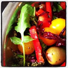 """""""Insane market salad- 100 mile ingredients: yellow cherry tomatoes, red pepper, arugula, grated beet pickles, home-made pesto!"""" (taken at Evergreen Brick Works, Toronto)"""