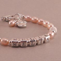 Personalized Name Bracelet, pink pearls, little girls jewelry, birthday bracelets, cupcake charm, heart, toddler, baby. $42.00, via Etsy.