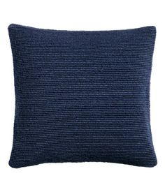 Dark blue. Cushion cover in a soft, textured knit with wool content. Woven cotton fabric at back. Concealed zip.