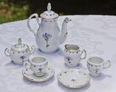 Miniature Porcelain Tea Set White w Lavender Floral Motif, Teapot w Lid, Sugar w Lid, Creamer, Two Cups w Two Saucers.