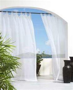 Tab top drapery panels outdoors.