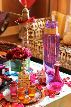 Moroccan Display I used Mod Podge glue and hot pink food coloring to dye the mini canister on the table, and then I spray painted the wood piece gold, Jessie says. The larger vase was already purple so I just painted some twine gold and wrapped Moroccan Party, Moroccan Style, Indian Style, Design Marocain, Morrocan Decor, Moroccan Bathroom, Moroccan Lamp, Boho Bathroom, Pink Food Coloring