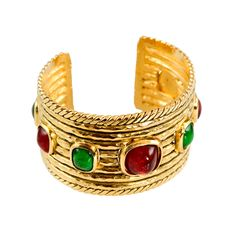 Gold Tone Cuff with Poured Glass Accents by Chanel   From a unique collection of vintage cuff bracelets at http://www.1stdibs.com/jewelry/bracelets/cuff-bracelets/