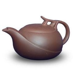 I didn't realize this but it is a cast iron tea pot.  Very cool looking though and definitely worth trying to make this in clay