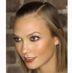 """Bronzing at its most sophisticated: with blended warm shades ranging from peach to tan. The full effect is reinforced by colour structuring the mouth, cheeks and eyes.""  Karlie Kloss at Donna Karan"