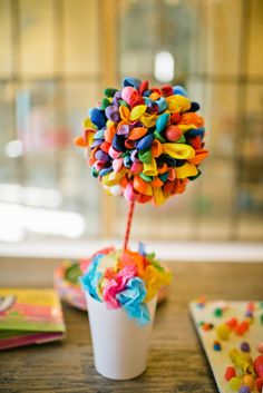 Make a topiary with water baloons pinned to styrofoam balls. candy-land-theme-party-18
