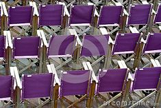 A viewing area set up with mauve fabric chairs.