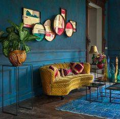 Blue walls with a carved wooden doorframe yellow gold couch Dark Interiors, Colorful Interiors, Living Room Carpet, Living Room Decor, Living Rooms, Bedroom Carpet, Bedroom Wall, Living Area, Casa Milano