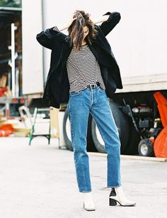 Give your mom jeans a Parisian twist by pairing them with a basic striped top, an oversize boyfriend blazer, and street-cool metallic ankle boots. A classic black leather belt and unfussy bed hair will prove the perfect accessories.