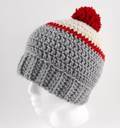 There something so right about the classic pompom crochet beanie, like the Ice Fishing Beanie. Worked in a simple stitch and featuring a classic fold-up ribbing and a little pompom at the very top of the hat, this crochet hat pattern is classic. Chunky Crochet Hat, Crochet Adult Hat, Crochet Beanie Pattern, Crochet Cap, All Free Crochet, Crochet For Boys, Crochet Scarves, Knitted Hats, Crochet Patterns