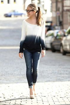 boyfriend jeans, ombre top, wide framed glasses, and nude heels