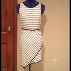 Knit dress NWT HOST PICK X3!! This cream and black asymmetrical dress is really unique. Black piping separates the unusual cuts of this dress. Sized as large but fits like medium. NWT. Dresses