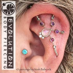 Healed four point #industrialpiercing with #whitegold #platinum #rainbowmoonstone #ametyhst and #bluetopaz jewelry by #bvla photographed at more than 5 years old