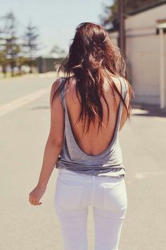 open back with white pants.