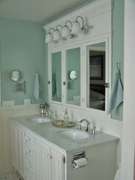 Great idea to make the mirror serve as a medicine cabinet and yet retain traditional beauty.