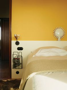 Farrow & Ball's Babouche yellow enlivens one of the bedrooms. Tagged: Bedroom, Bed, and Wall Lighting. Yellow Modern Home Design Ideas by Matthew Keeshin from Modern Home Furnished With Flea Market Finds. Browse inspirational photos of modern bedrooms. Interior Design Issues, Half Painted Walls, Mustard Yellow Walls, Yellow Interior, Color Interior, Design Moderne, Bedroom Wall, Yellow Bedroom Paint, Wall Colors