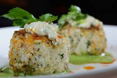 "Is there any dish more reminiscent of dining at the shore than a crab cake? Leave it to Bobby Flay to give the classic recipe a run for its money by introducing our palettes to his ""Lobster-Crab Cake with..."