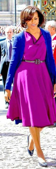Michelle Obama wears a cowl-necked dress with cardigan