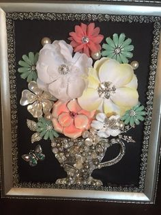 Framed Vintage Jewelry Artwork  This is a beautiful one of a kind flower bouquet made from a combination of vintage/costume jewelry. The