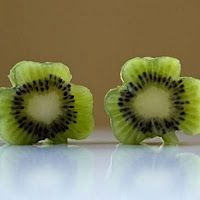 Kiwi shamrocks  for top of St. Patrick's Day trifle. Kids use cookie cutters on fruit. Whole Food healthy raw vegan