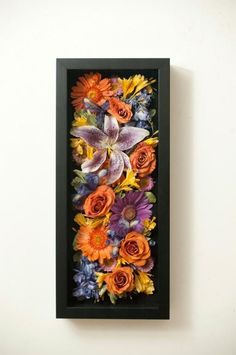 Dried wedding bouquet displayed in a shadow box.