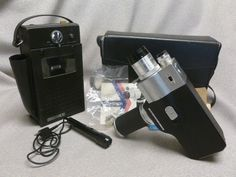 "A totally vintage 8mm camera and a ""news interview"" style tape recorder with microphone!!!  Check out our auction at www.MichiganOnlineAuctions.com    New lots added daily..  Spread the word!!!"