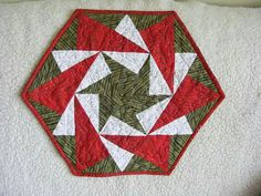 Use a 60 degree ruler..triangle...use a strip set...two fabrics sew together...lay ruler on strip set..point goes on the seam..base of tri angle is equal for red & white fabric...the middle...look at the pic and you can see how they laid out....your 60 degree triangle has equal sides....it does make it easy...