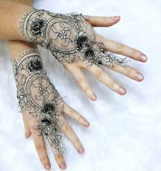 Love how the dainty floral embellishments add a dramatic 3D effect to these lace gloves.