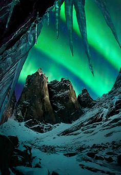 Under the Lights - The aurora over enormous peaks in Canada's Yukon territory.  Camped out right here for four days recently, waiting and hoping for this shot.  Luckily those icicles didn't go anywhere in the frigid temps.  I used a 13-image blend for DOF to capture the scene exactly how it looked to me standing there.  The image was shot at 30mm under the light of the half moon which was illuminating the background peaks but hidden behind a large face to my right, allowing a better…